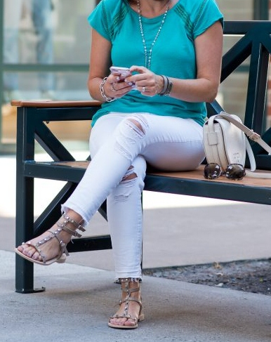 teal-tee-with-gladiator-sandals-and-white-crop-jeans-sitting-700x700